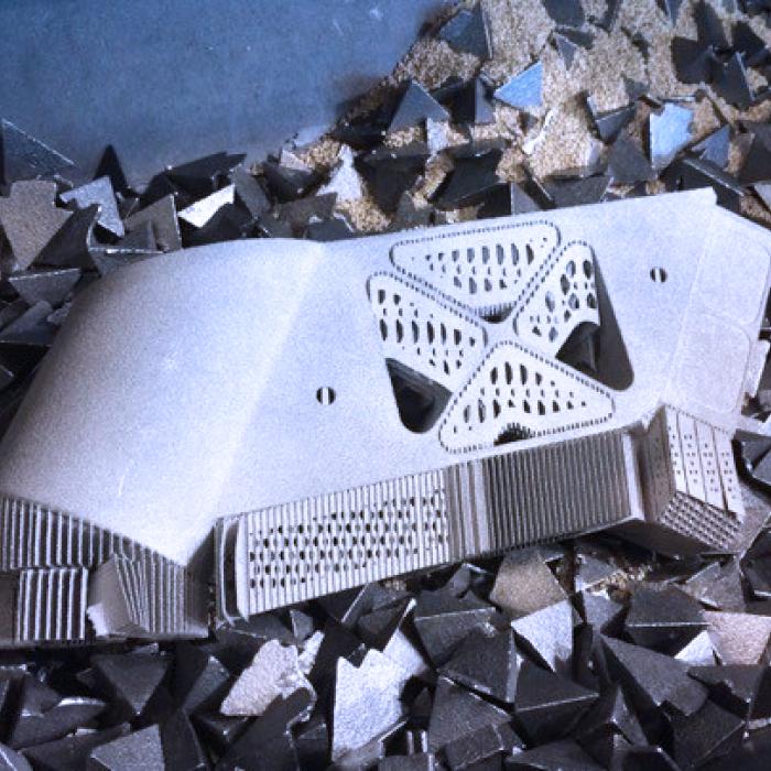 Ebavurage en tonneau, Vos Besoins - Parachèvement et enlèvement de support en fabrication additive - SPK Solutions